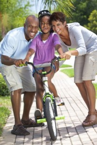 parents with child on bike19608554_s